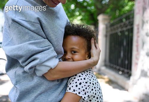 Midsection of mother with small daughter in city, hugging. - gettyimageskorea