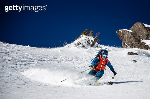 Man Skiing On Snowcapped Mountain Against Clear Sky - gettyimageskorea