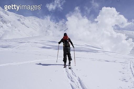 Full Length Of Man Walking On Snowcapped Landscape Against Sky During Winter - gettyimageskorea
