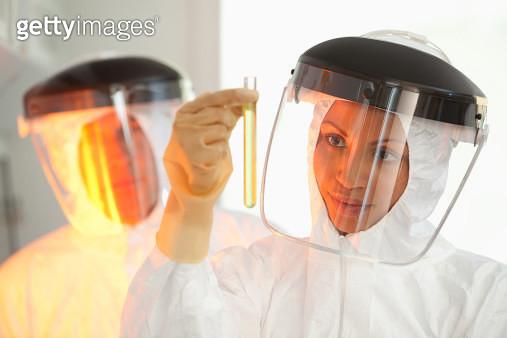 Scientist examining test tube in lab - gettyimageskorea