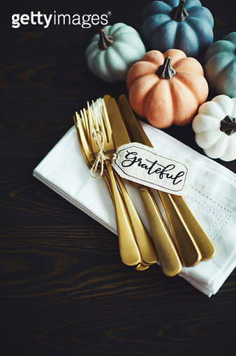 Thanksgiving Table Setting Background with Pumpkins and Gold Cutlery - gettyimageskorea