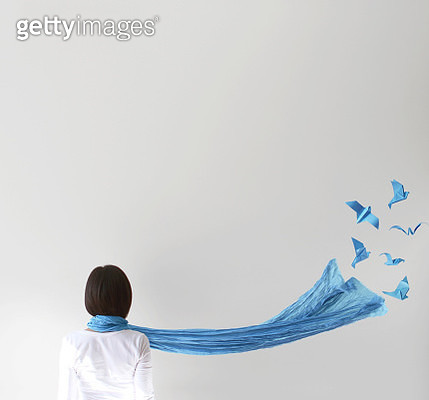 Rear view of woman with blue scarf and  origami birds - gettyimageskorea