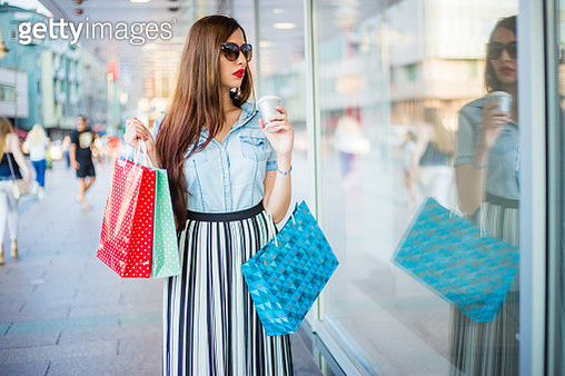Young woman with shopping bags - gettyimageskorea