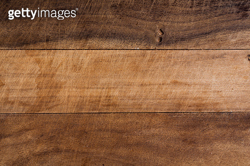 Top view of used wooden cutting board with several knife blade marks - gettyimageskorea