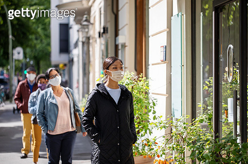 Group of people waiting in social distance outside a pharmacy - gettyimageskorea