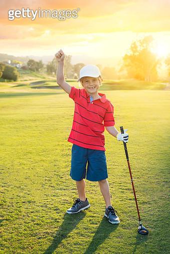 Young Boy Golfer Celebrating During Sunset - gettyimageskorea