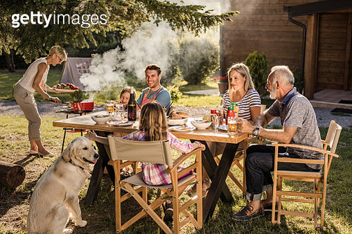Happy multi-generation family enjoying in lunch time at their back yard. - gettyimageskorea