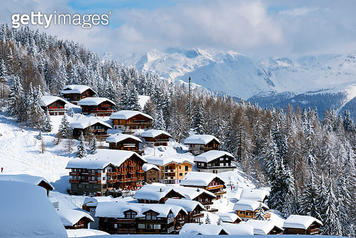 Switzerland, Canton Valais, Bettmeralp, Snow-capped houses on hill - gettyimageskorea
