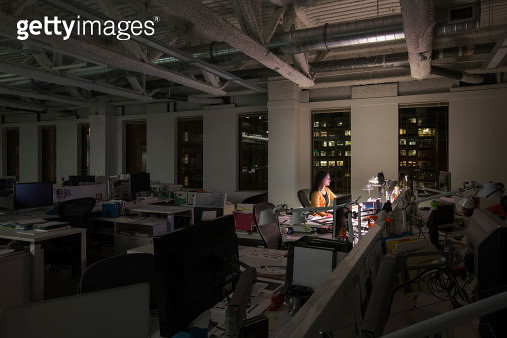 Mixed race businesswoman working late in office - gettyimageskorea