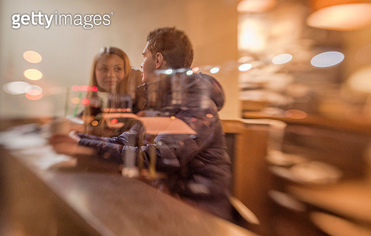Man and women in the Starbucks cafe - gettyimageskorea