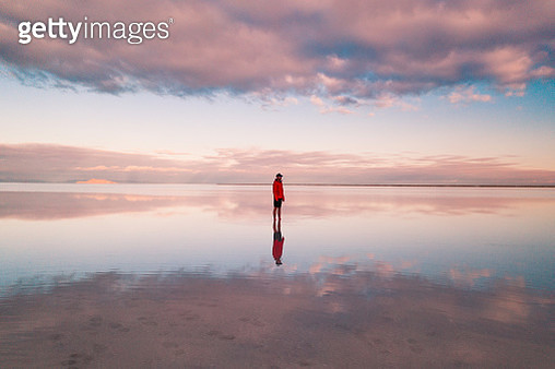 One person standing on the flooded Bonneville salt flats, Utah, United States of America - gettyimageskorea
