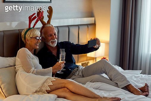 Senior Couple Getting Ready For New Year Party - gettyimageskorea