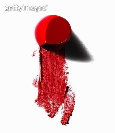 Abstract of piece of red lipstick and smudged line - gettyimageskorea
