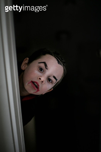 portrait of  vampire boy peeking from door - gettyimageskorea
