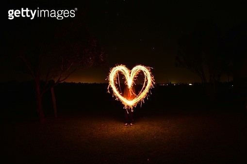 Illuminated Light Painting Against Sky At Night - gettyimageskorea
