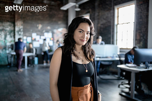 Portrait confident creative businesswoman in loft office - gettyimageskorea