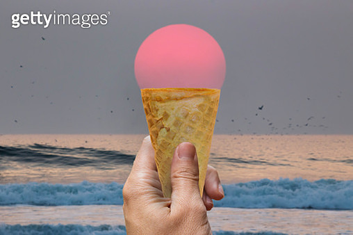 Creative picture of ice cream cone matching with big sunset sun. - gettyimageskorea