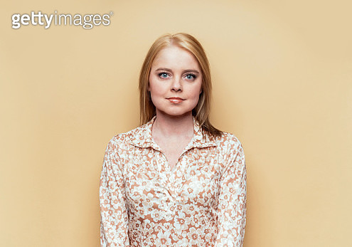 beautiful young woman on beige background - gettyimageskorea