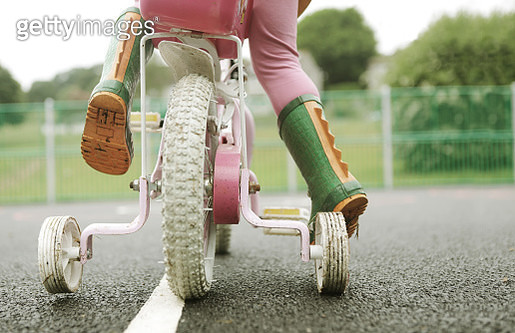 Toddler on bicycle with stabilizers - gettyimageskorea