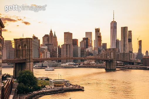 View of New York Skyline and Brooklyn Bridge during sunset - gettyimageskorea