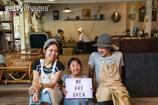 Family with one child in front of their new small business cafe and restaurant - gettyimageskorea