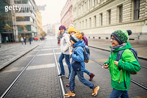 Mother with three kids sightseeing city of Brno. Family is sightseeing the city on cold Autumn day. Sightseeing is fun even in the bad weather!Nikon D850 - gettyimageskorea