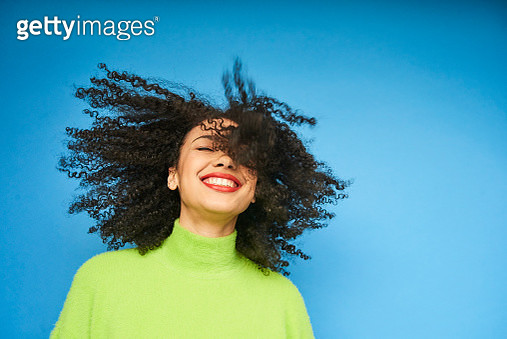 Colourful studio portrait of a young woman dancing - gettyimageskorea