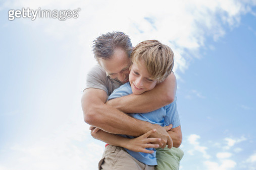 Father hugging son - gettyimageskorea