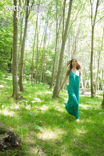 Young woman running through woods - gettyimageskorea
