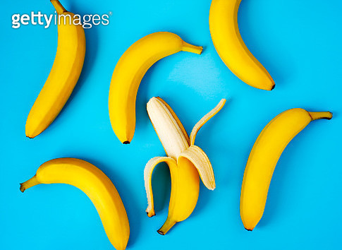 Ripe bananas on blue background - gettyimageskorea