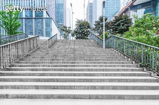 empty staircase between modern office buildings - gettyimageskorea