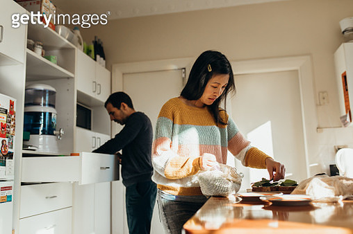 Australian real life multiethnic couple make cheese sandwiches together - gettyimageskorea