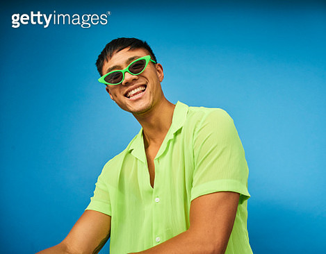 Colourful studio portrait of a young man - gettyimageskorea