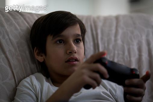 Boy playing video games - gettyimageskorea