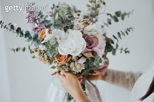 Midsection Of Woman Holding Bouquet While Standing Outdoors - gettyimageskorea
