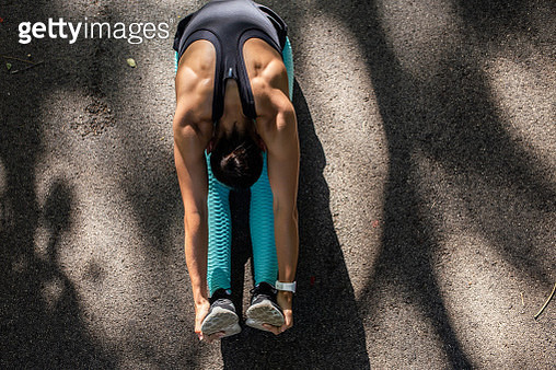 Girl stretching before starting her workout routine - gettyimageskorea