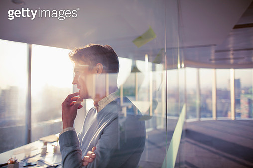 Man standing with ideas in planning office room - gettyimageskorea