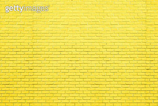 Yellow bricks pattern on wall for abstract background. - gettyimageskorea