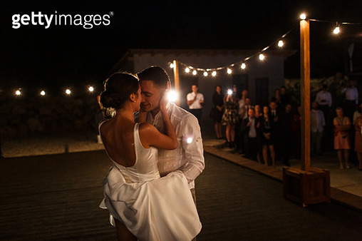 Newlyweds are kissing at the dancing stage - gettyimageskorea