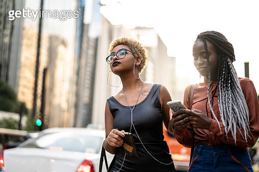 Two Businesswoman Waiting for the Transport - gettyimageskorea