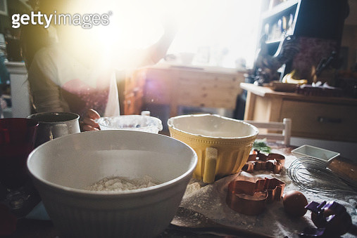 A girl baking holiday cookies. - gettyimageskorea