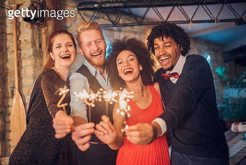 Young people holding sparklers - gettyimageskorea