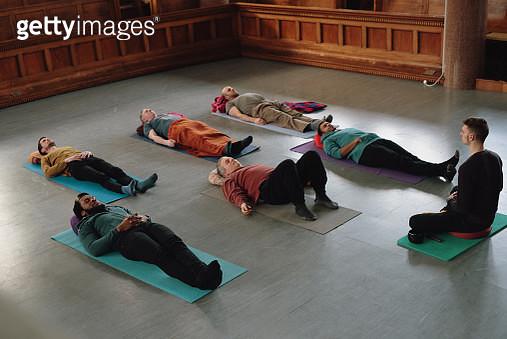 All male Yoga class - Savasana - gettyimageskorea