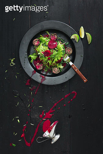 Salad with meat rolls and beetroot sauce. - gettyimageskorea