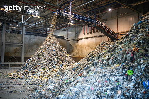 Piles of Separated Recyclables Inside Waste Facility - gettyimageskorea