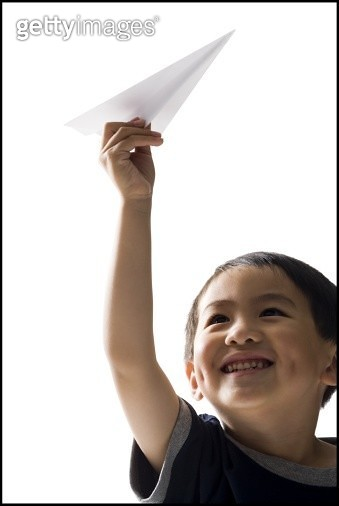 Child playing with paper airplane - gettyimageskorea