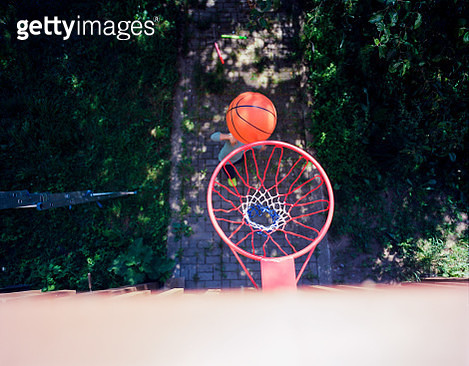 Basketball flying towards basketball hoop from above - gettyimageskorea