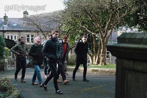 A group of men walking - gettyimageskorea