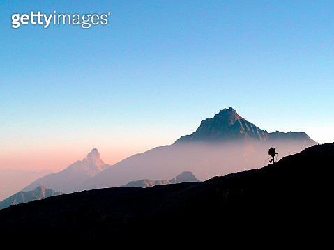 Sunrise over the hiker on steep ridge in Gran Paradiso National Park, Aosta Valley, Italy - gettyimageskorea
