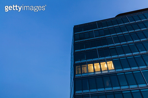 Germany, Baden-Wuerttemberg, office building at night - gettyimageskorea